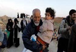 عائلات الموصل تخاطر للفرار وسط رصاص القناصة