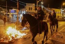 مواجهات في أبو ديس ودعوات لمسيرة غاضبة وإضراب الخميس